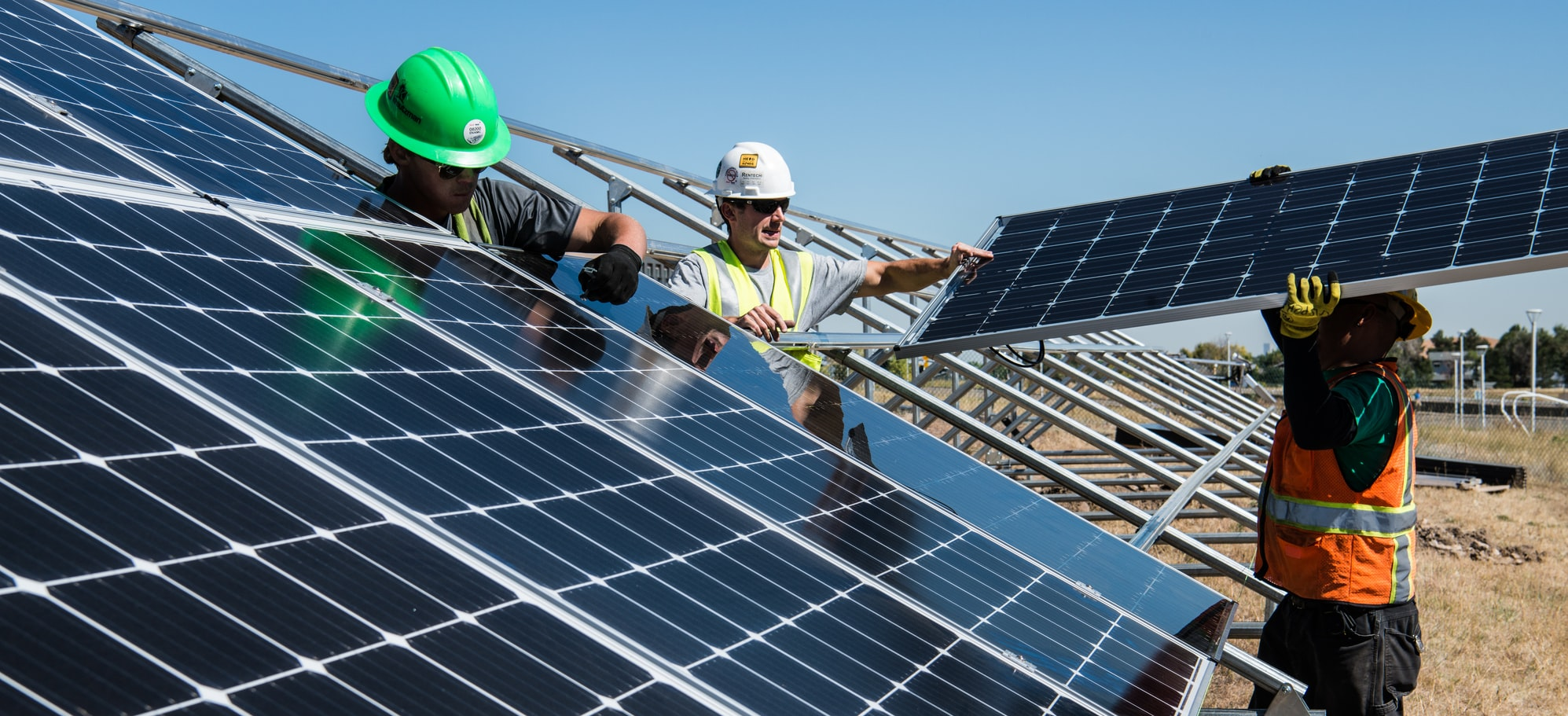 Workers fitting Solar Panels - 50001 Energy